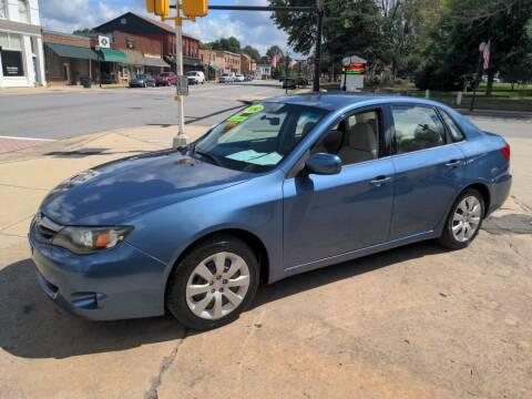 2010 Subaru Impreza for sale at ROBINSON AUTO BROKERS in Dallas NC