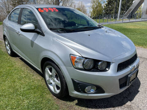 2014 Chevrolet Sonic for sale at BELOW BOOK AUTO SALES in Idaho Falls ID