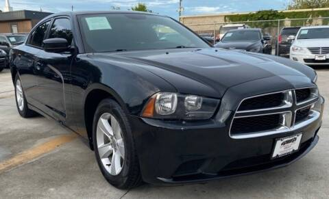 2012 Dodge Charger for sale at DYNAMIC AUTO GROUP in Houston TX