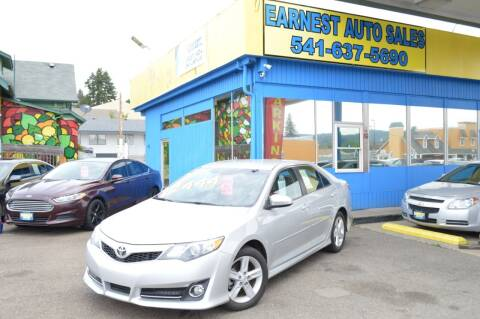 2014 Toyota Camry for sale at Earnest Auto Sales in Roseburg OR