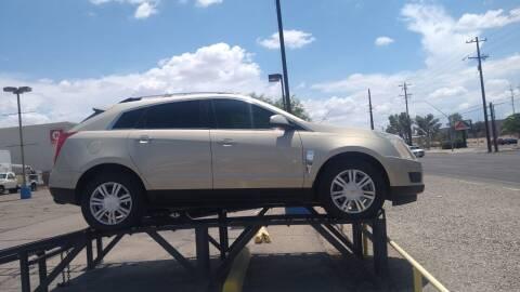 2011 Cadillac SRX for sale at CAMEL MOTORS in Tucson AZ