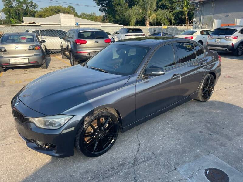2012 BMW 3 Series for sale at P J Auto Trading Inc in Orlando FL