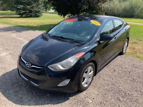 2013 Hyundai Elantra for sale at BELOW BOOK AUTO SALES in Idaho Falls ID