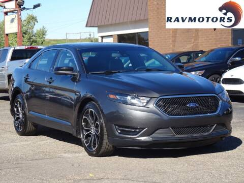 2018 Ford Taurus for sale at RAVMOTORS in Burnsville MN
