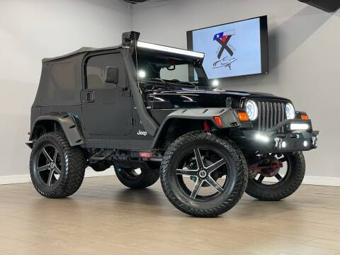 2002 Jeep Wrangler for sale at TX Auto Group in Houston TX