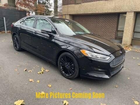 2014 Ford Fusion for sale at Warner Motors in East Orange NJ