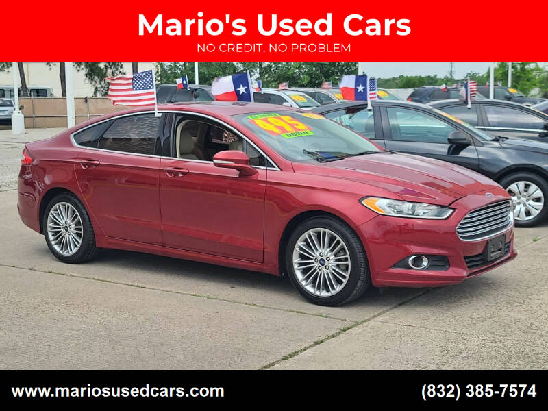 2014 Ford Fusion for sale at Mario's Used Cars in Houston TX