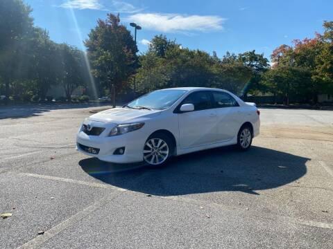 2009 Toyota Corolla for sale at Uniworld Auto Sales LLC. in Greensboro NC