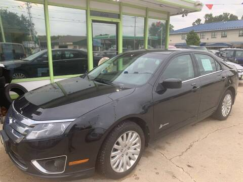 2011 Ford Fusion Hybrid for sale at Super Trooper Motors in Madison WI