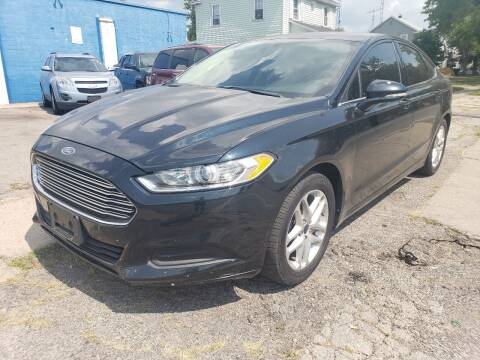 2014 Ford Fusion for sale at M & C Auto Sales in Toledo OH