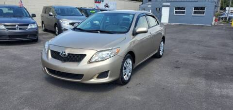 2009 Toyota Corolla for sale at Real Car Sales in Orlando FL