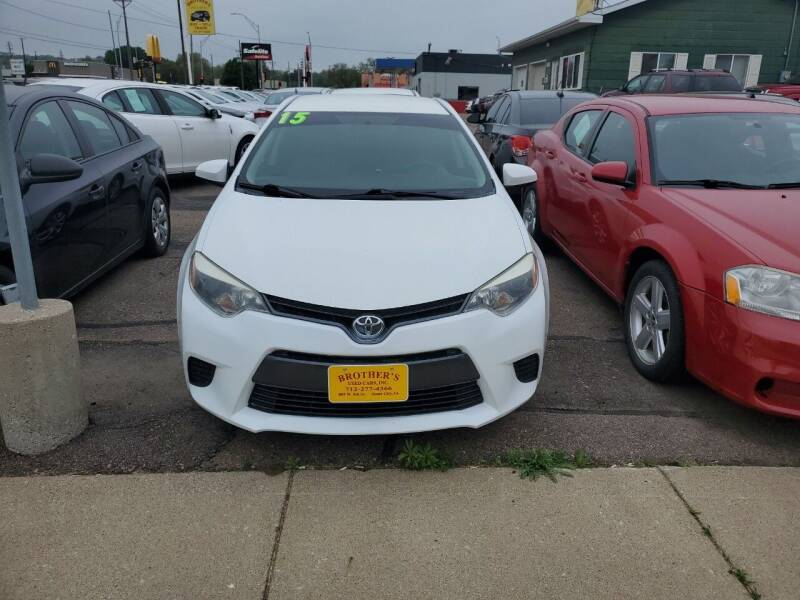 2015 Toyota Corolla for sale at Brothers Used Cars Inc in Sioux City IA
