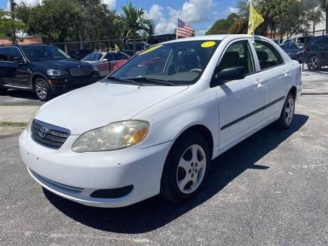 2007 Toyota Corolla for sale at EZ Own Car Sales of Miami in Miami FL