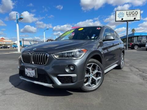 2017 BMW X1 for sale at LUGO AUTO GROUP in Sacramento CA