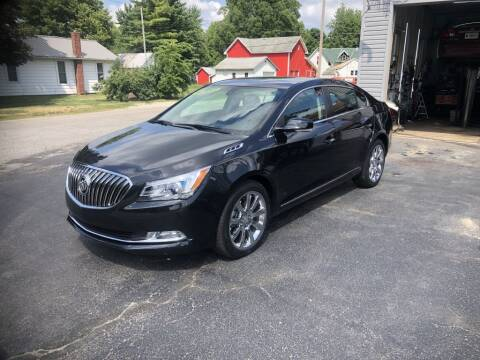 2014 Buick LaCrosse for sale at The Car Mart in Milford IN