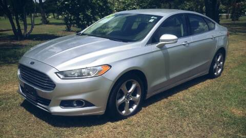 2013 Ford Fusion for sale at H & H AUTO SALES in San Antonio TX