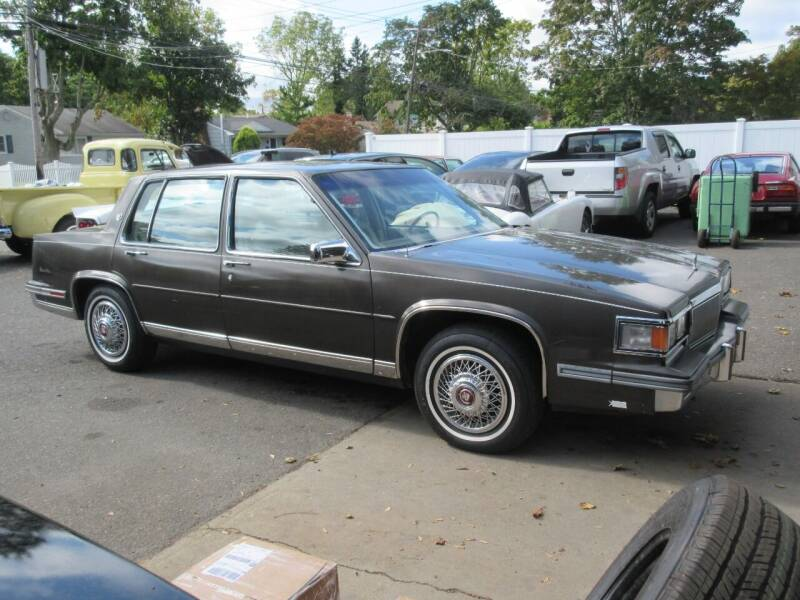 1986 Cadillac DeVille for sale at Island Classics & Customs in Staten Island NY