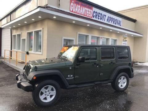 2009 Jeep Wrangler Unlimited for sale at Suarez Auto Sales in Port Huron MI