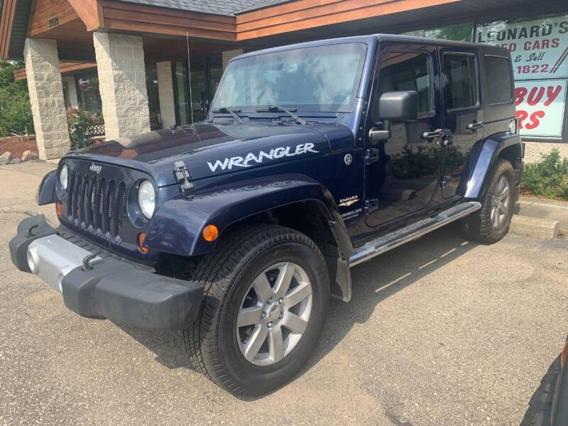2013 Jeep Wrangler Unlimited for sale at Leonard Enterprise Used Cars in Orion Township MI