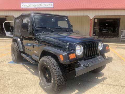 1997 Jeep Wrangler for sale at PITTMAN MOTOR CO in Lindale TX