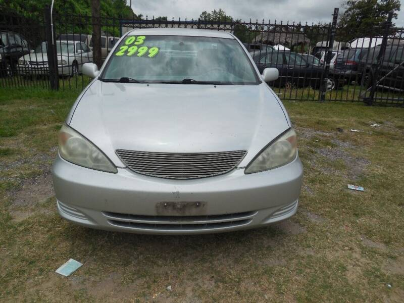 2003 Toyota Camry for sale at SCOTT HARRISON MOTOR CO in Houston TX