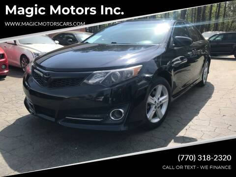 2013 Toyota Camry for sale at Magic Motors Inc. in Snellville GA