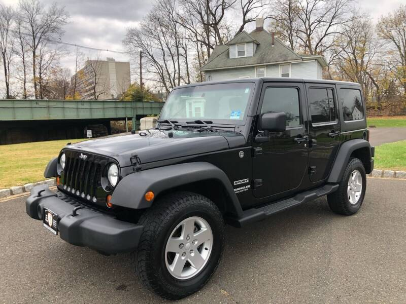 2012 Jeep Wrangler Unlimited for sale at Mula Auto Group in Somerville NJ