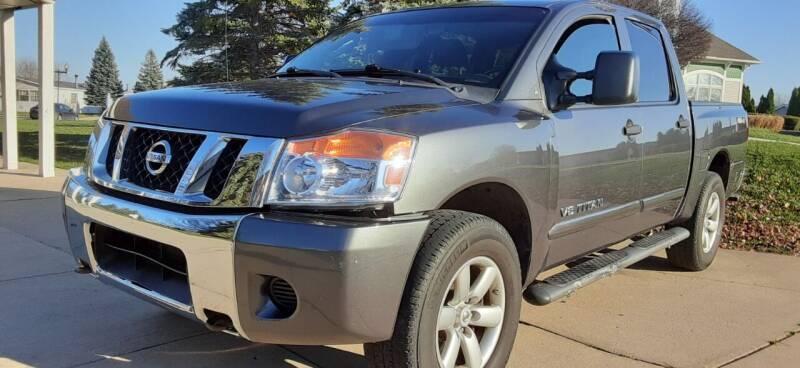 2009 Nissan Titan for sale at Heartbeat Used Cars & Trucks in Harrison Twp MI