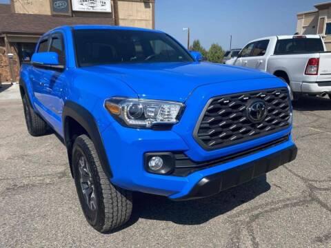 2020 Toyota Tacoma for sale at BERKENKOTTER MOTORS in Brighton CO