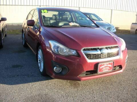 2014 Subaru Impreza for sale at Lloyds Auto Sales & SVC in Sanford ME