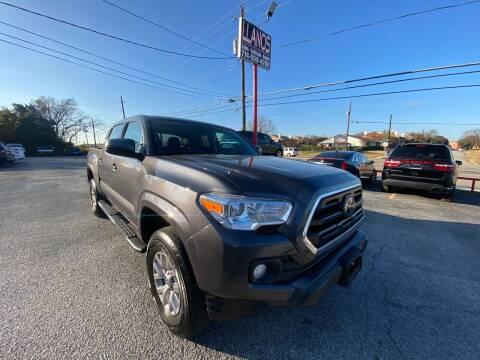 2019 Toyota Tacoma for sale at LLANOS AUTO SALES LLC in Dallas TX