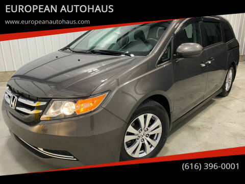 2014 Honda Odyssey for sale at EUROPEAN AUTOHAUS in Holland MI