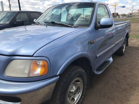 1997 Ford F-150 for sale at BARNES AUTO SALES in Mandan ND