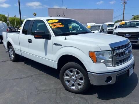 2013 Ford F-150 for sale at Auto Wholesale Company in Santa Ana CA