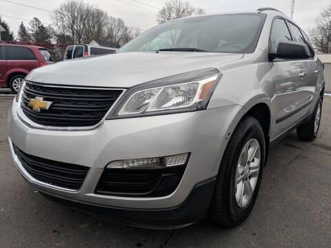 2014 Chevrolet Traverse for sale at Rombaugh's Auto Sales in Battle Creek MI