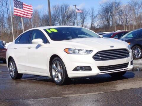 2014 Ford Fusion for sale at Szott Ford in Holly MI