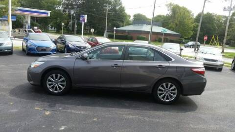 2015 Toyota Camry for sale at VINE STREET MOTOR CO in Urbana IL