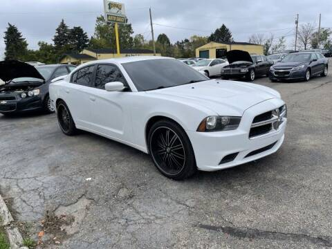 2013 Dodge Charger for sale at RPM AUTO SALES in Lansing MI