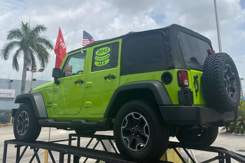 2013 Jeep Wrangler Unlimited for sale at Navarro Auto Motors in Hialeah FL