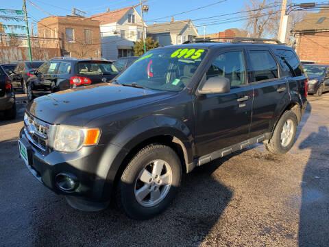 2009 Ford Escape for sale at Barnes Auto Group in Chicago IL