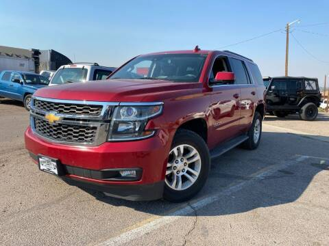 2015 Chevrolet Tahoe for sale at BERKENKOTTER MOTORS in Brighton CO