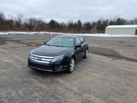 2011 Ford Fusion for sale at Caruzin Motors in Flint MI