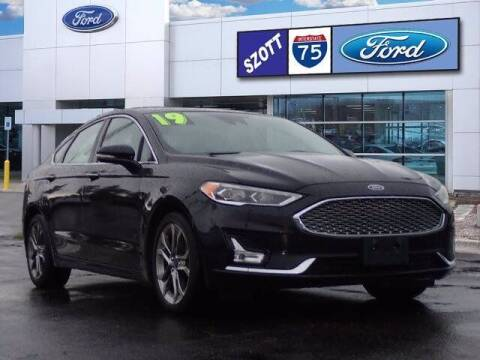 2019 Ford Fusion Hybrid for sale at Szott Ford in Holly MI