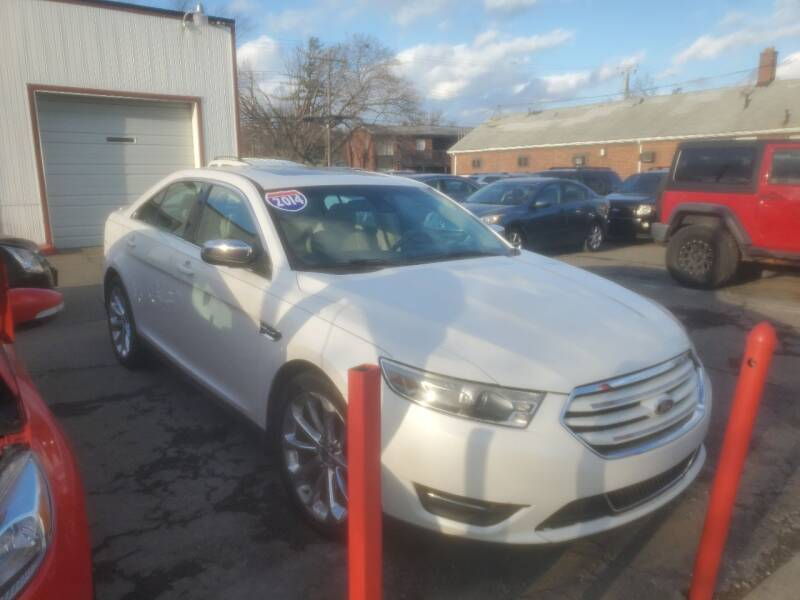 2014 Ford Taurus for sale at J & J Used Cars inc in Wayne MI