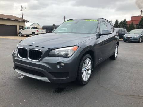 2013 BMW X1 for sale at Mike's Budget Auto Sales in Cadillac MI