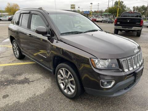 2014 Jeep Compass for sale at RPM AUTO SALES in Lansing MI