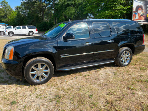 2010 GMC Yukon XL for sale at TOP OF THE LINE AUTO SALES in Fayetteville NC