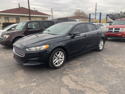2014 Ford Fusion for sale at Robert B Gibson Auto Sales INC in Albuquerque NM