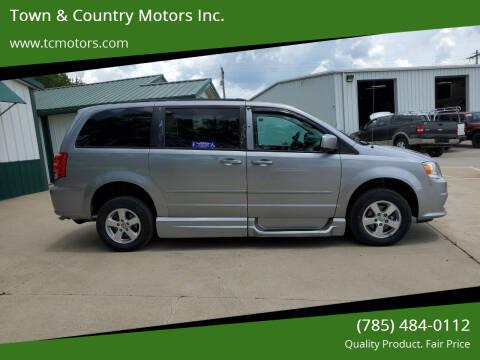 2013 Dodge Grand Caravan for sale at Town & Country Motors Inc. in Meriden KS