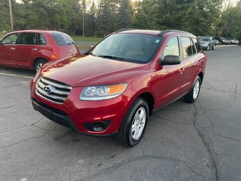 2012 Hyundai Santa Fe for sale at Northstar Auto Sales LLC in Ham Lake MN